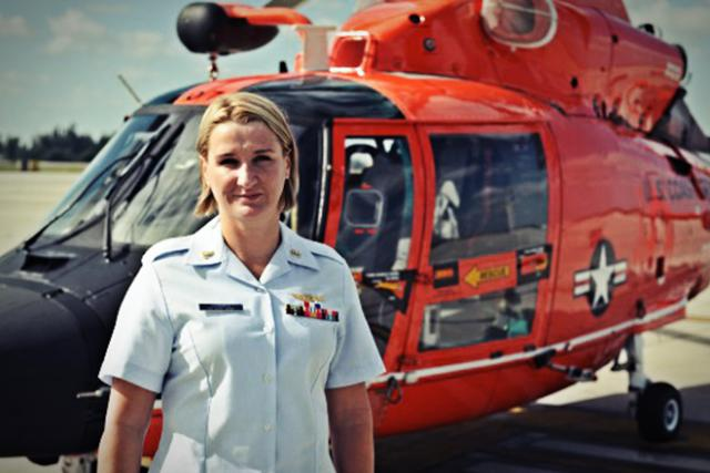 Petty Officer stands before Rescue Helicopter