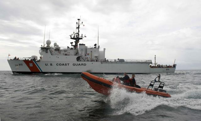 270 foot Coast Guard cutter deploys its rigid hull inflatable boat during training exercises.