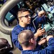 Photo of a machinery technician learning how to work on an engine.
